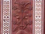 Floral designs carved in the red stone of the Taj Mahal Mosque