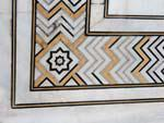 Intricate decorative borders from coloured stone inlays
