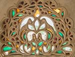 Intricate stone carved coloured windows