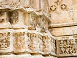 Chipmunk eating on the carvings of Jagdish Temple