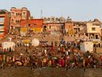 Many local Indians at Kedar Ghat with a temple in the background