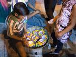Boy selling candles to be floated on the Ganges, a puja offering