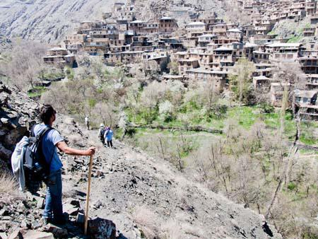 Travis climbing the hill overlooking Kang village