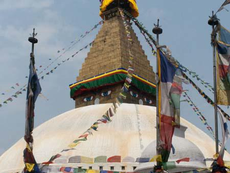 The Bodhnath Stupa surrounded by Buddhist prayer flags