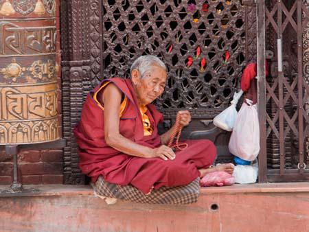 Monk sitting next to the stupa