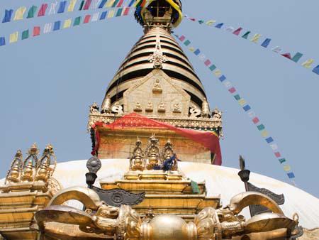 At the base of the Swayambhunath stupa with the Buddhist Vajra thunderbolt visible