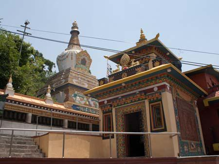 A Buddhist monastery at the base of the hill