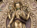 Intricate brass Buddha relief near Seto Machhendranath Temple