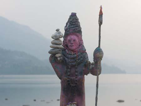 A religious deity on the banks of Lake Phewa Tal