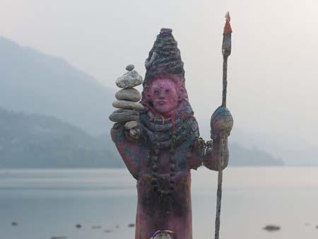 A religious deity on the banks of Lake Phewa Tal