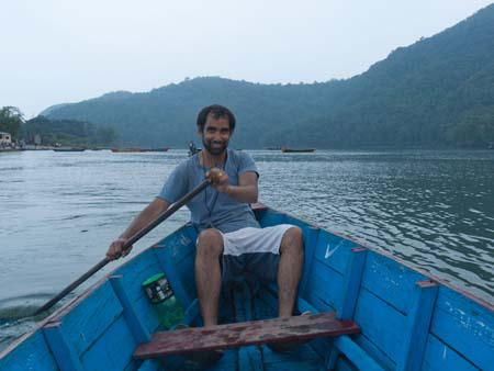 Travis in canoe on Lake Phewa Tal