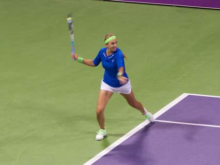 Victoria Azarenka returning a serve