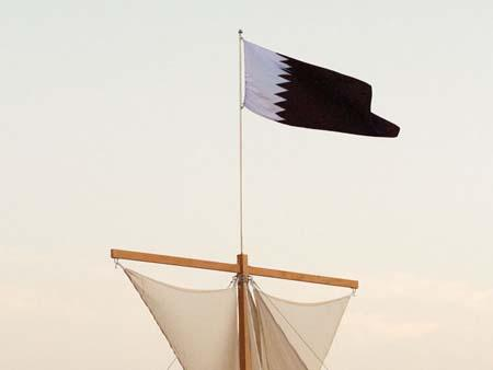 Entrance to the exhibition, Qatar flag on sails