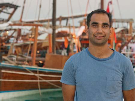 Travis with dhows in the background