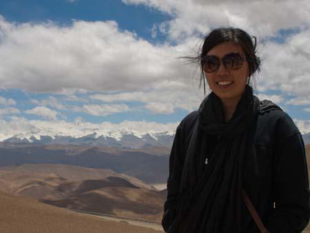 Sonya with the tip of Mount Everest visible in the background