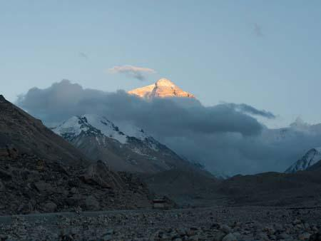 Mount Everest seen at sunset when its highlighted golden