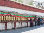 Tibetans turning prayer wheels at Drepung Monastery