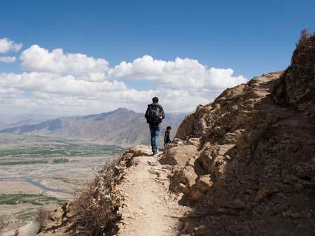 Travis on the high narrow paths of the Kora