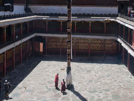 Large courtyard with prayer pole in the centre