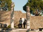 Travis and Sukey at the  Sanctuary of Trajan Trajaneum Stoa